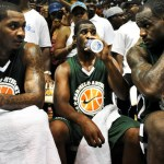 Carmelo Anthony, Chris Paul and LeBron James talk during halftime during the Goodman League All-Stars taking on The Melo League basketball game at Edward P. Hurt Gymnasium at Morgan State University on August 30, 2011 in Baltimore