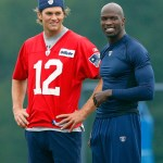 Tom Brady #12 and Chad Ochocinco of the New England Patriots chats during training camp at Gillette Stadium on July 29, 2011 in Foxborough, Massachusetts