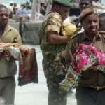 (Authorities carry the bodies of babies from ship that sank off the coast of Tanzania Saturday, September 10, 2011)
