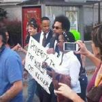"Cornel West before being arrested on the steps of the Supreme Court in D.C. carrying a picket sign with a Gandhi quote ""Poverty is the worst form of violence."" October 16, 2011"