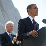 Vice President Joe Biden applauds as US President Barack Obama arrives at the microphone to speak during the dedication of the Martin Luther King Jr. Memorial October 16, 2011 in Washington, DC. AFP PHOTO/Mandel NGAN (Photo credit should read MANDEL NGAN/AFP/Getty Images)