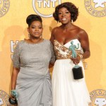 Actresses Octavia Spencer (L) and Viola Davis pose in the press room with their award for Outstanding Performance By A Cast In A Motion Picture for 'The Help' during the 18th Annual Screen Actors Guild Awards at The Shrine Auditorium on Jan. 29, 2012 in Los Angeles