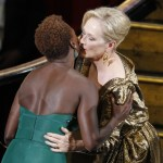 "Meryl Streep, right, is congratulated by Viola Davis before accepting the Oscar for best actress in a leading role for ""The Iron Lady"" during the 84th Academy Awards on Sunday, Feb. 26, 2012, in Hollywood"