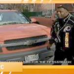 Danny White of D.C. stands next to his vehicle with the infamous tag: 'NO TAGS'