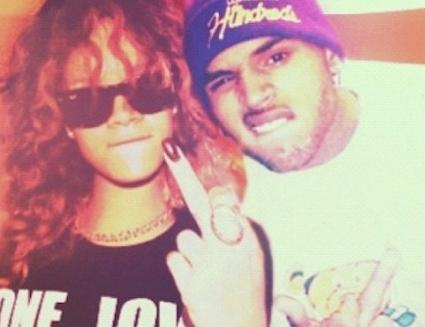 rihanna and chris brown ((finger & scowl)