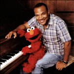 kevin clash &amp; elmo at piano