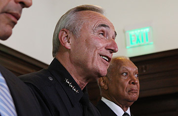 Former LAPD Chief William Bratton (center) with LAPD Board of Police Commissioners Vice-President John Mack (right).