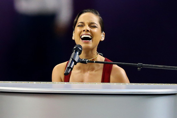 Musician Alicia Keys performs the National Anthem prior to the start of Super Bowl XLVII between the Baltimore Ravens and the San Francisco 49ers at the Mercedes-Benz Superdome on February 3, 2013 in New Orleans