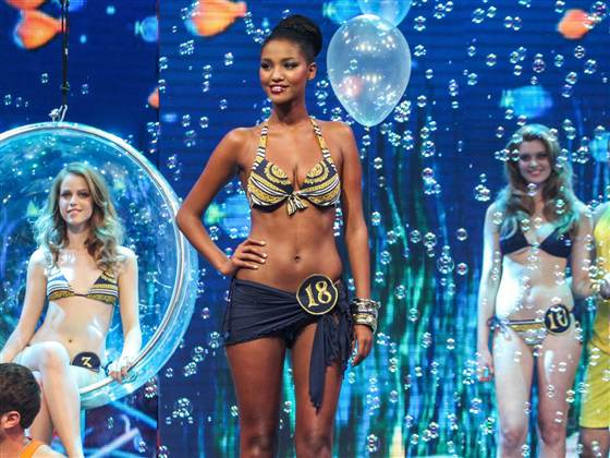 Yityish Aynaw, age 21 or 22 according to various reports, stands with other contestants during the swim suit part of the Miss Israel 2013 beauty pageant in Haifa, northern Israel, on Feb. 27.