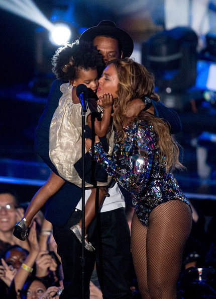 Rapper Jay Z and singer Beyonce with daughter Blue Ivy Carter onstage during the 2014 MTV Video Music Awards at The Forum on August 24, 2014 in Inglewood