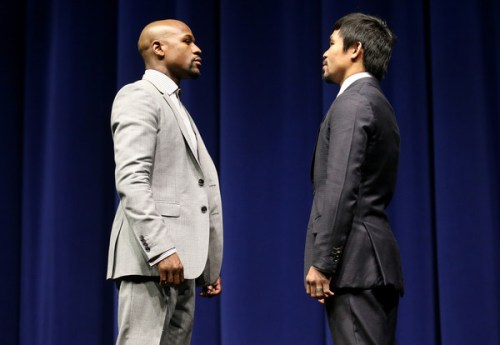 Floyd Mayweather (L) and Manny Pacquiao face off at the start of their Press Conference promoting their upcoming fight on March 11, 2015 in Los Angeles, California