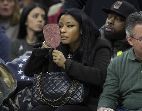 Nicki Minaj looks at herself in a mirror during the game between the Golden State Warriors and Philadelphia 76ers on January 30, 2016 at the Wells Fargo Center in Philadelphia, Pennsylvania.