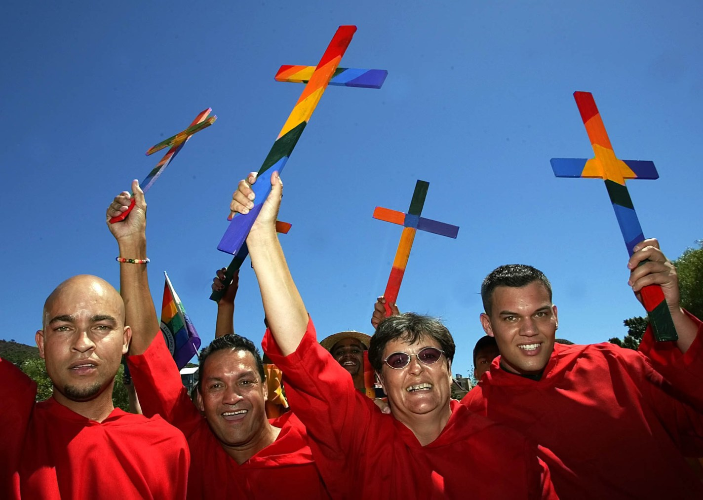 "Members of the Good Hope Metropolitan Community Church in Cape Town smile during the annual Gay Pride Parade in Cape Town, South Africa, Saturday, Feb. 26. 2005. The participants chanted slogans saying ""Jesus would have marched at pride"". (AP Photo/Obed Zilwa)"