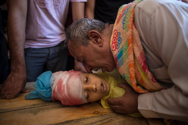 Ibrahim Dawawsa's father crying over the boy's body-Wissam Nassar for The New York Times