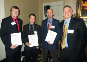Four Anne Arundel Community College students were recognized for their projects at the Chesapeake Bay Region Chapter of the American Institute of Architects Design Awards Banquet in December. From left are students, Bret Woods of Glen Burnie, who won a Merit Award; Richard McCallum of Pasadena who won a Citation Award; and Ryan Blomeley of Annapolis, who won a Merit Award; with Richard Kleponis, AIA, LEED AP BD+C, principal with WGM Architects and chair of the student awards committee. Not pictured is AACC alumnus Bernard Jeffers of Severna Park, who won an Honor Award. Jeffers is continuing his architectural studies at University of Colorado Denver.