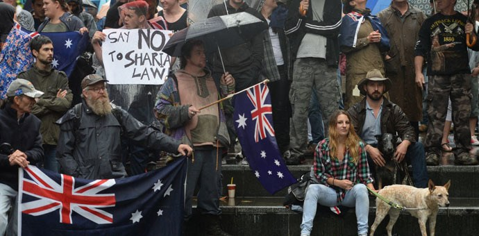 "Protesters attend a ""Reclaim Australia"" rally to oppose religious extremism in Sydney on April 4, 2015. (AFP Photo/Peter Parks)"