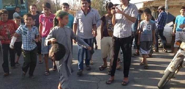 Muslim children playing with severed head