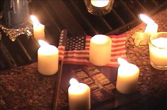 flag-and-candles-at-washington-square-park-memorial