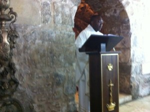 Fr. Justus celebrates Mass in an underground crypt within the Church of the Holy Sepulcher.