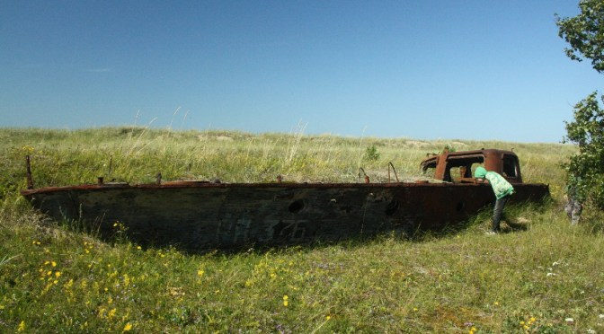 ... like an ancient boat, 50 m away from the beach.