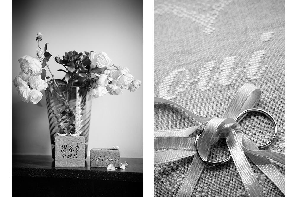 Les jolis détails d'un mariage : porte-alliances en pierre de volvic devant un bouquet et les alliances sur un coussin brodé d'un oui. Photographies en noir et blanc de fanny reynaud, photographe professionnelle de mariage en auvergne.