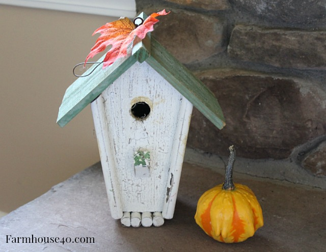 birdhouse-gourde-on-fireplace-hearth