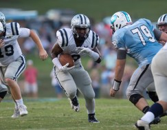 Amon Johnson rushes for a first down against Gibbs on 8/26. PHOTO CREDIT: Carlos Reveiz, CRFOTO.com