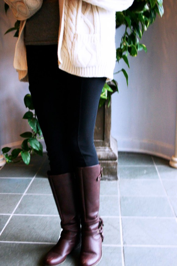 Emily from FBC- Vintage, oversized cable knit cardigan, ALDO earrings, black leggings, brown riding boots