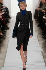 A look from Oscar de la Renta's fall 2014 show embraces the feminine form with a defined waist.