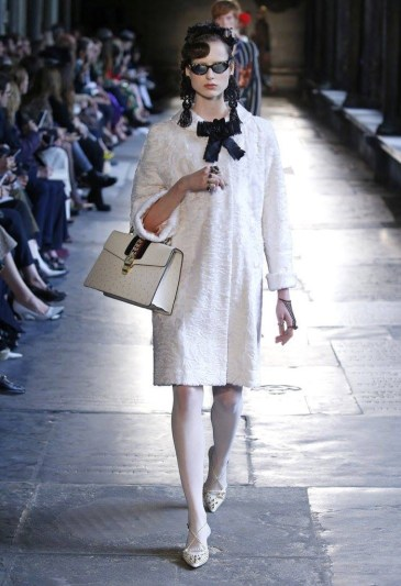 Model walks the runway at gucci s resort 2017 show wearing a