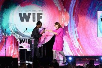 BEVERLY HILLS, CA - JUNE 13: Honoree Victoria Alonso accepts The Lexus Beacon Award from Isaach de Bankole onstage during the Women In Film 2018 Crystal + Lucy Awards presented by Max Mara,Lancôme and Lexus at The Beverly Hilton Hotel on June 13, 2018 in