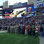 Patriots Chairman and CEO Robert Kraft greets Foxborough resident and World War II veteran Edward Mousseau at The Hall at Patriot Place presented by Raytheon prior to Sunday's Patriots-Lions game at Gillette Stadium.
