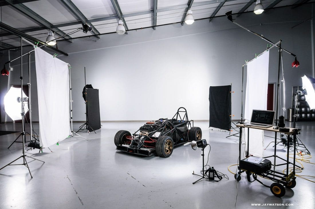 a race car inside a photo studio