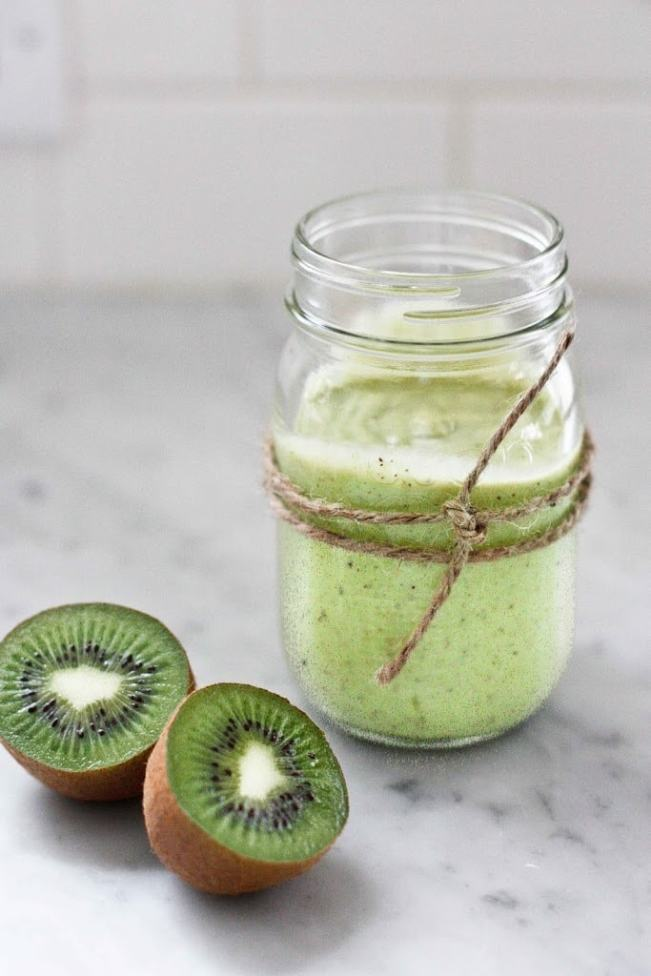 A simple tasty recipe for Avocado Smoothie with Kiwi and lime, sweetened with honey ( or maple). Deliciously addicting and easy to make! | www.feastingathome.com