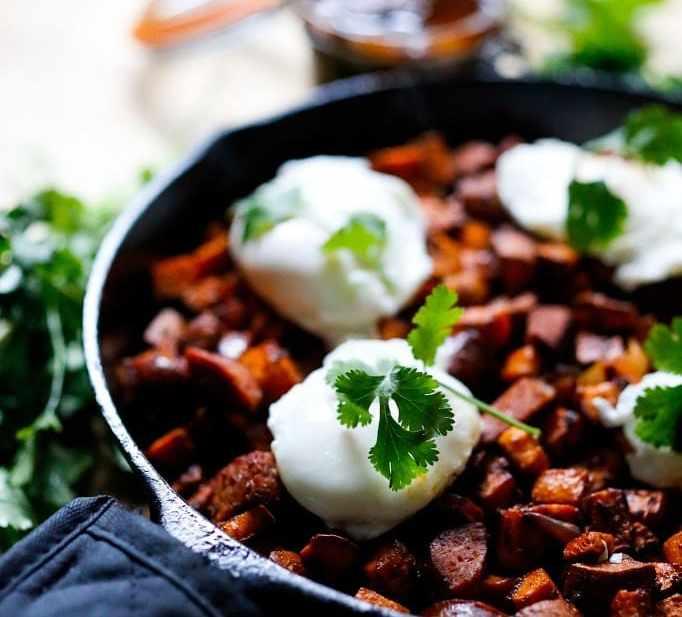 Sweet potato hash with Harissa, poached eggs and mergeuz sausage | www.feastingathome.com