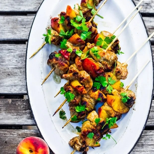 Grilled Jerk Chicken and Peach Skewers   www.feastingathome.com