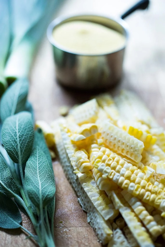 "corn, pancetta and sage, served over a ""lightened-up"" creamy polent..."