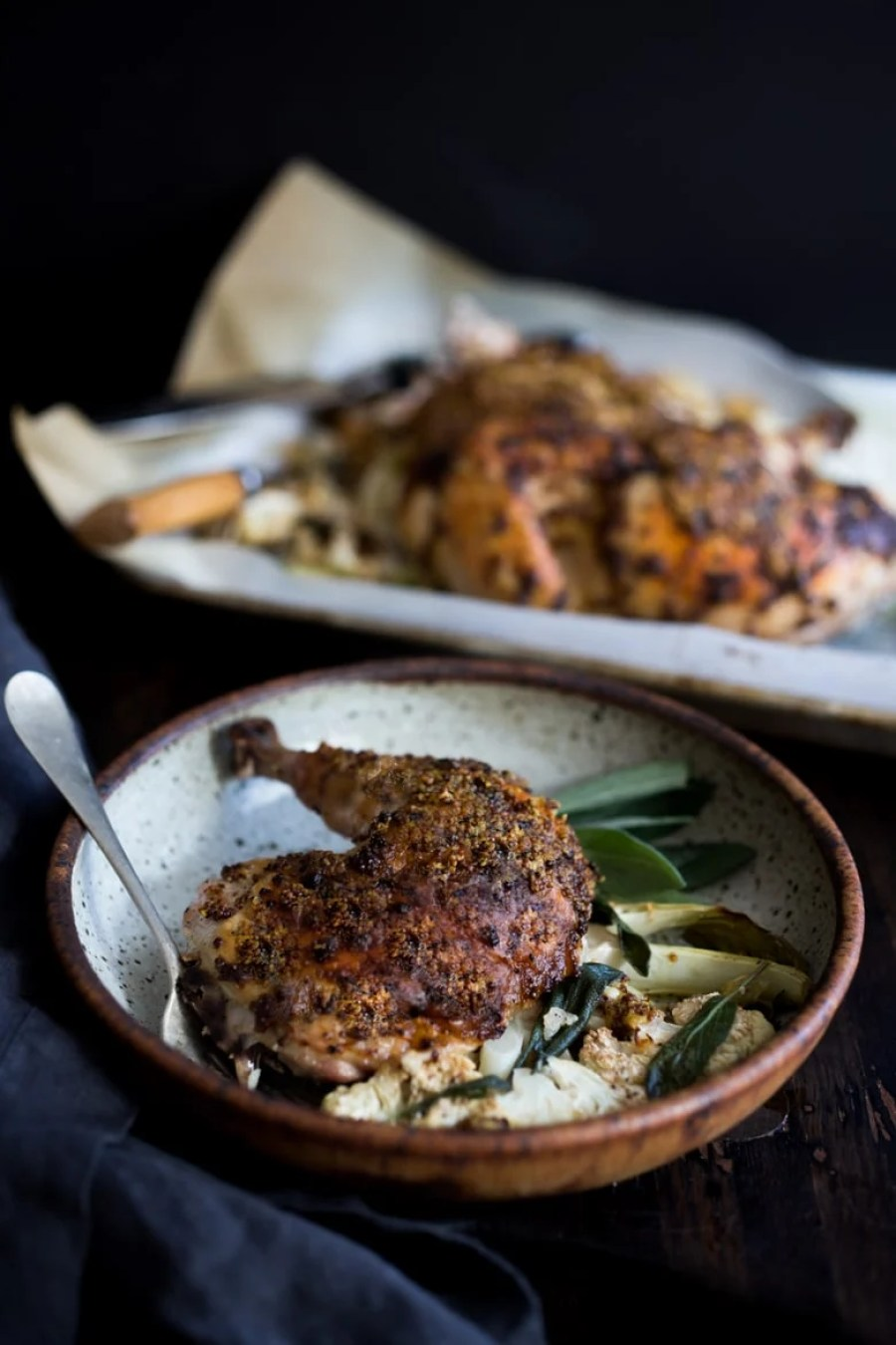 Mustard Roasted Chicken baked over Cauliflower steaks- a delicious one-pan meal!