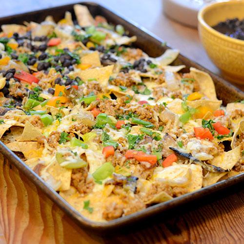 nachos, Mexican, cheese, ground turkey, black beans, peppers & cilantro