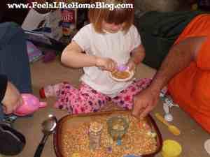 pouring lentils sensory tub