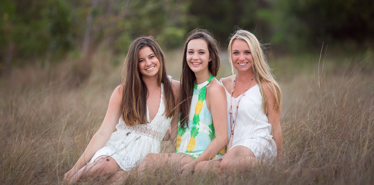 high school seniors posing on their photo session in key west florida