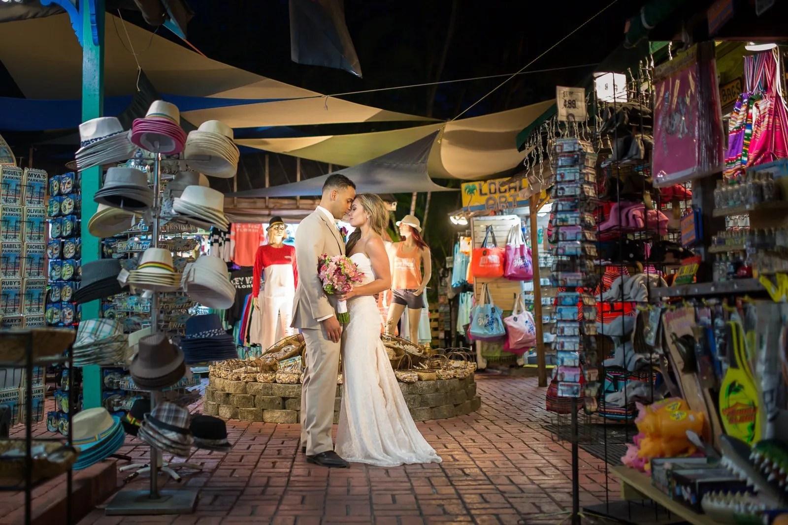 bride and groom posing on duval street