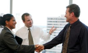 Group of professionals greet each other at their office