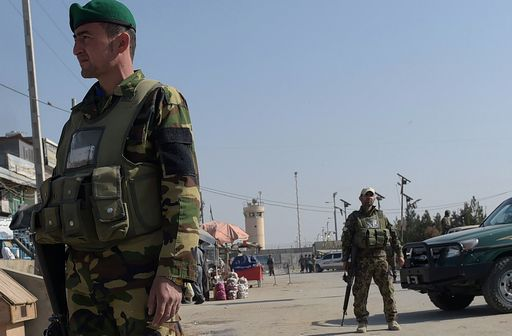Afghan security personnel keep watch near the largest US military base in Bagram, 50 km north of Kabul, after an explosion on November 12, 2016. Four people were killed November 12 in an explosion inside the largest US military base in Afghanistan, NATO said, with local officials blaming a suicide attacker posing as a labourer for the major security breach. / AFP PHOTO / SHAH MARAI