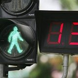 SGP, Singapore: Traffic light for pedastrians, display shows the remaining time. |