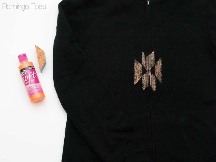 sponge painting a hoodie