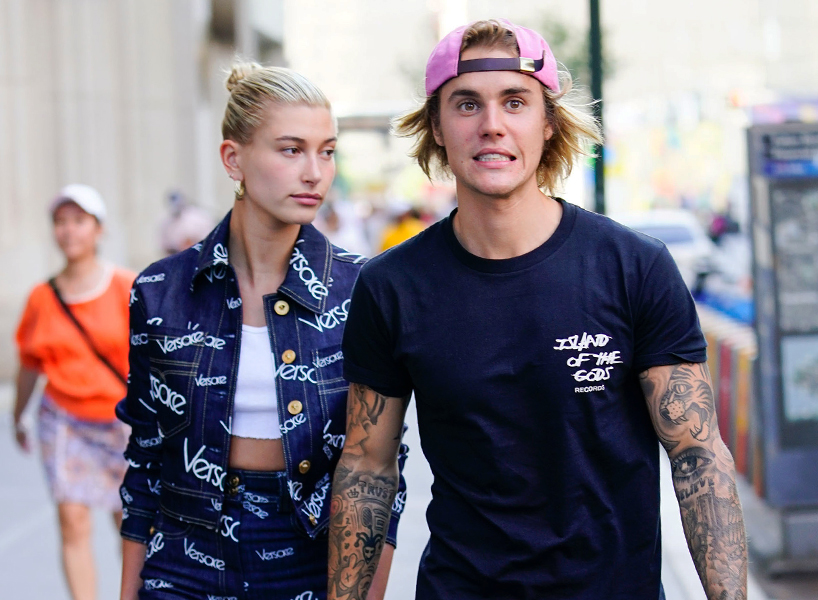 Justin Bieber Hailey Baldwin Engaged  3 Theories Why It s Fake   FLARE Justin Bieber making a  yikes  face and Hailey Baldwin looking off to the  side