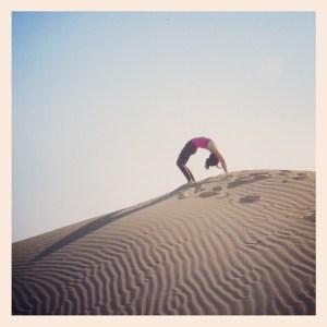 Practicing yoga on the Jaisalmer desert in India