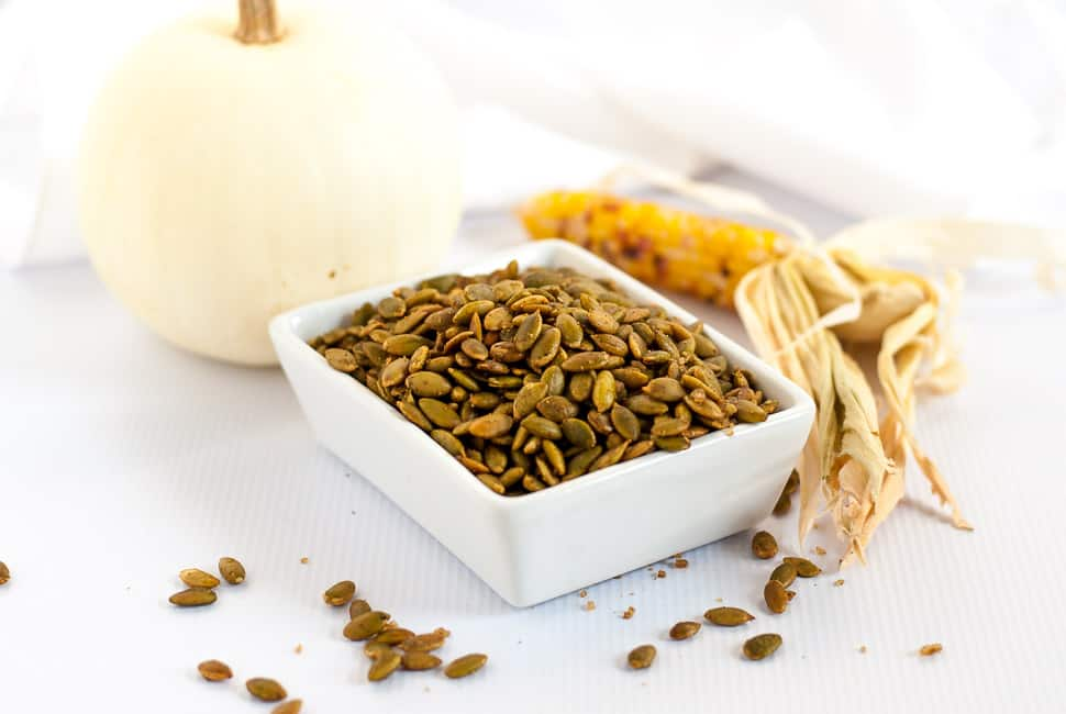 Spiced Pumpkin Seeds make a healthy snack, an addition to a cheese platter, or a garnish for soup or salad. They're mildly salty with a kick from chipotle peppers!|www.flavouradnsavour.com