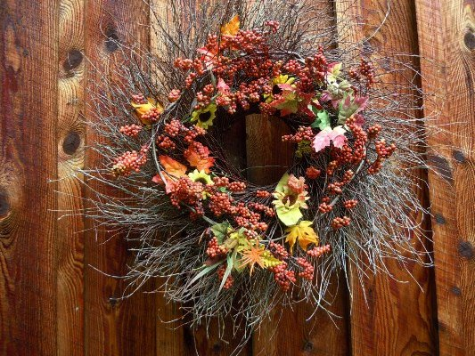 Christine Cross's rustic wreath against the barn